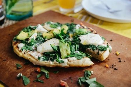 White pizza with avocado, spinach and mozzarella