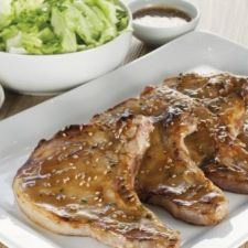 Pork chops marinated in honey mustard and sesame seeds