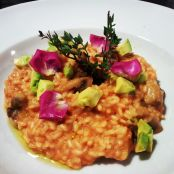 Risotto Milanese with avocado and flower petals