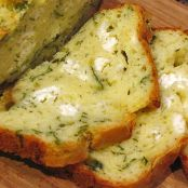 Loaf cake with feta cheese and fresh herbs