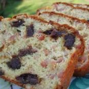 Savoury loaf with lardons, prunes and pine nuts