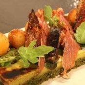 Summer vegetable tart with ham, figs and melon and rocket salad