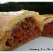 Beef turnovers with peppers and tomatoes