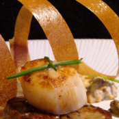 Scallops on a bed of foie gras with ceps
