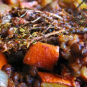 Pumpkin, tomato, onion and green lentil stew