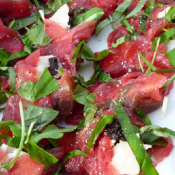 Carpaccio rolls with rocket and Parmesan