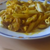 Pasta with lardons and mushrooms and curry sauce
