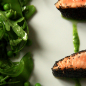 Poppy seed-crusted salmon with a green pea salad flavoured with Wasabi