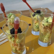 Verrines of salmon and avocado with sauce in their pipettes